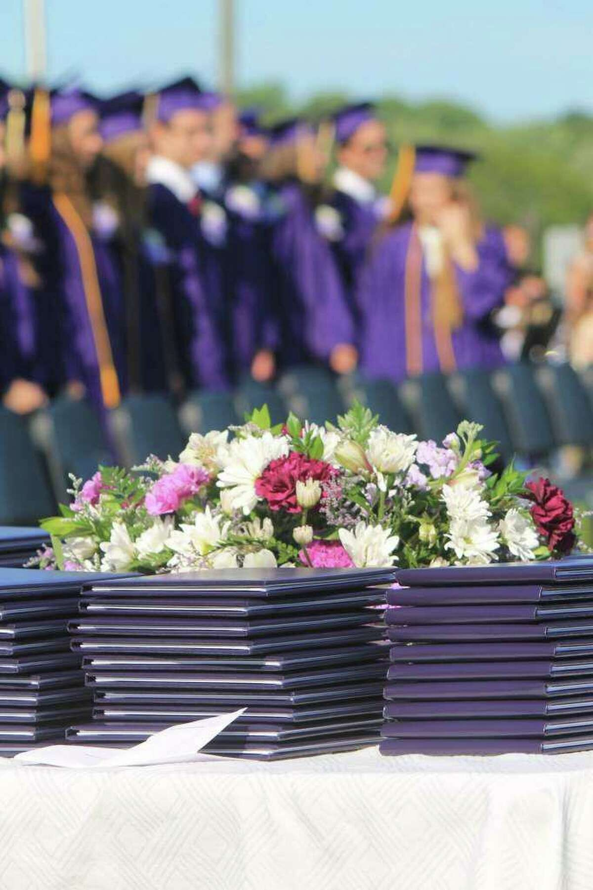FILE PHOTO - Diplomas are stacked at the Westbrook High School graduation ceremony 2018. The high school is planning to hold an outdoor prom on May 1 and graduation on June 11.