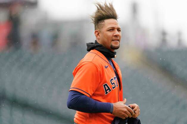 Houston Astros first baseman Yuli Gurriel waits for his hat and glove after flying out against Colorado Rockies starting pitcher Austin Gomber to end the top of the fourth inning of a baseball game Wednesday, April 21, 2021, in Denver. (AP Photo/David Zalubowski) Photo: David Zalubowski, Associated Press / Copyright 2021 The Associated Press. All rights reserved.