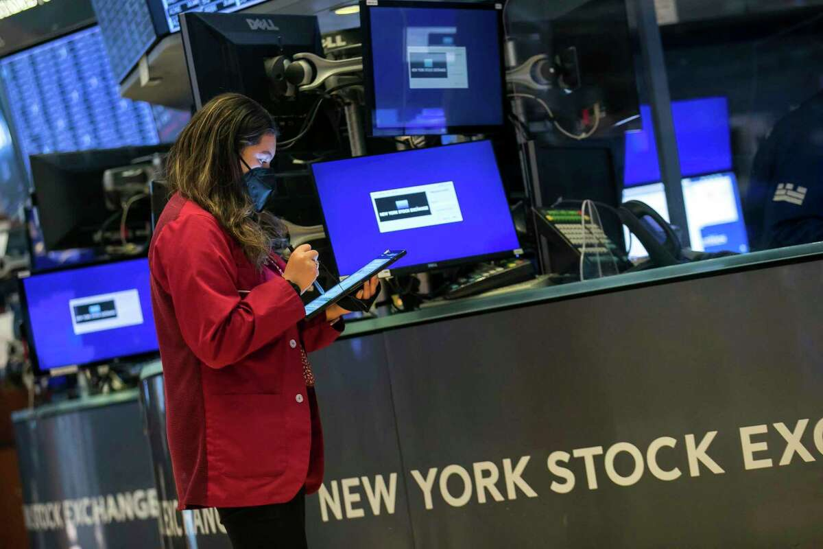 In this photo provided by the New York Stock Exchange, trader Ashley Lara works on the floor, Monday April 19, 2021. Greenwich, Conn.-based Interactive Brokers Group has benefited from a surge in trading among retail investors in the past year.