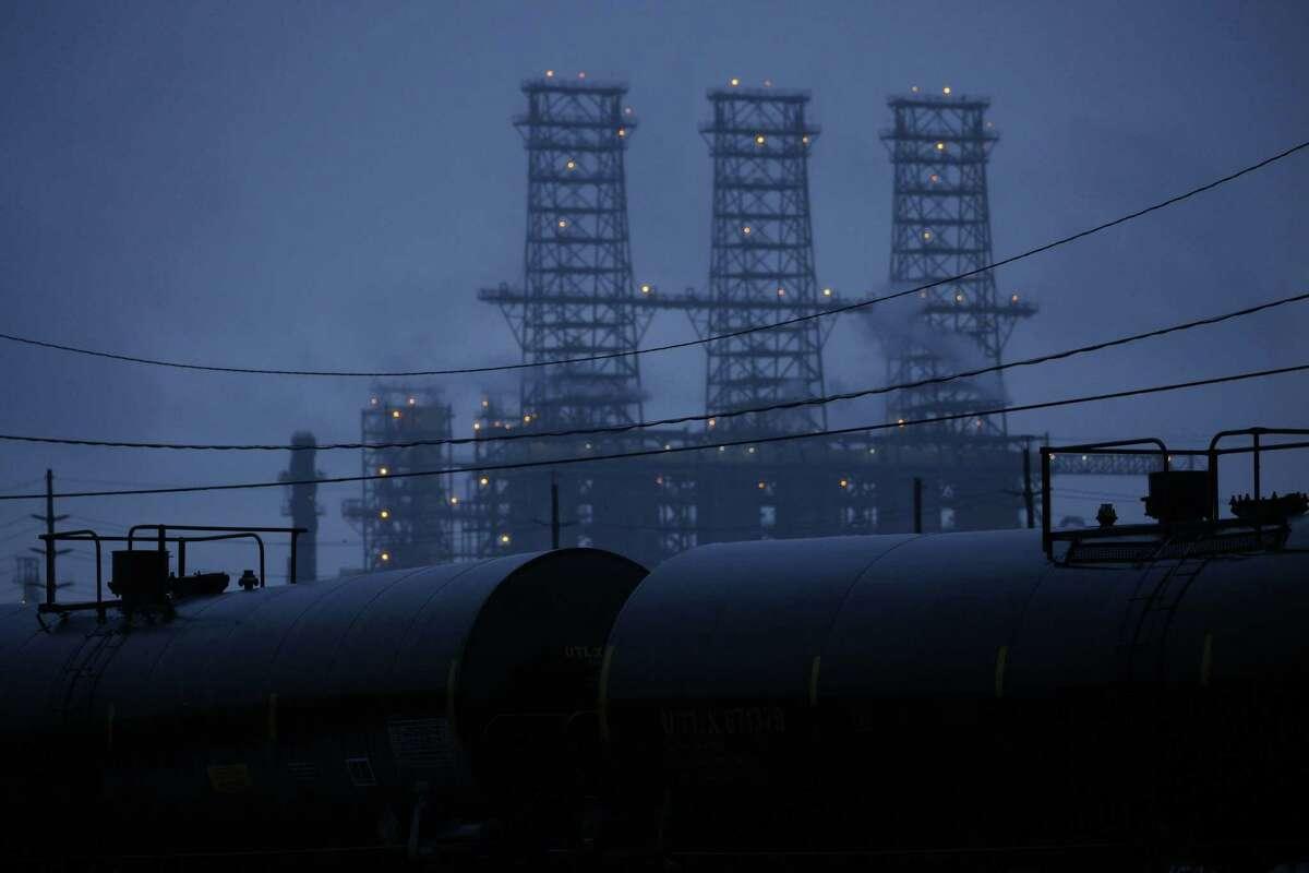 Rail tank cars sit near the Motiva Enterprises Refinery in Port Arthur, Texas, the largest refinery in the U.S., on Aug. 25, 2020. MUST CREDIT: Bloomberg photo by Luke Sharrett