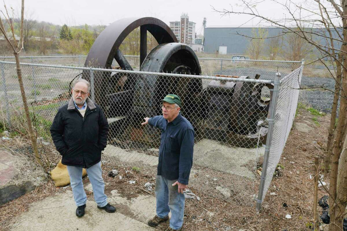 Michael Barrett, left, executive director of the Burnden Ironworks Museum, and Allen Cluett, talk about the process of moving the Corliss steam powered direct current generator, on Wednesday, April 21, 2021, in Troy, N.Y. The large generator will be moved to the Burnden Ironworks Museum property. (Paul Buckowski/Times Union)