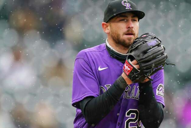 As snow swirls around him, Colorado Rockies starting pitcher Austin Gomber sets to deliver a pitch to a batter from the Houston Astros in the sixth inning of a baseball game Wednesday, April 21, 2021, in Denver. (AP Photo/David Zalubowski) Photo: David Zalubowski, Associated Press / Copyright 2021 The Associated Press. All rights reserved.