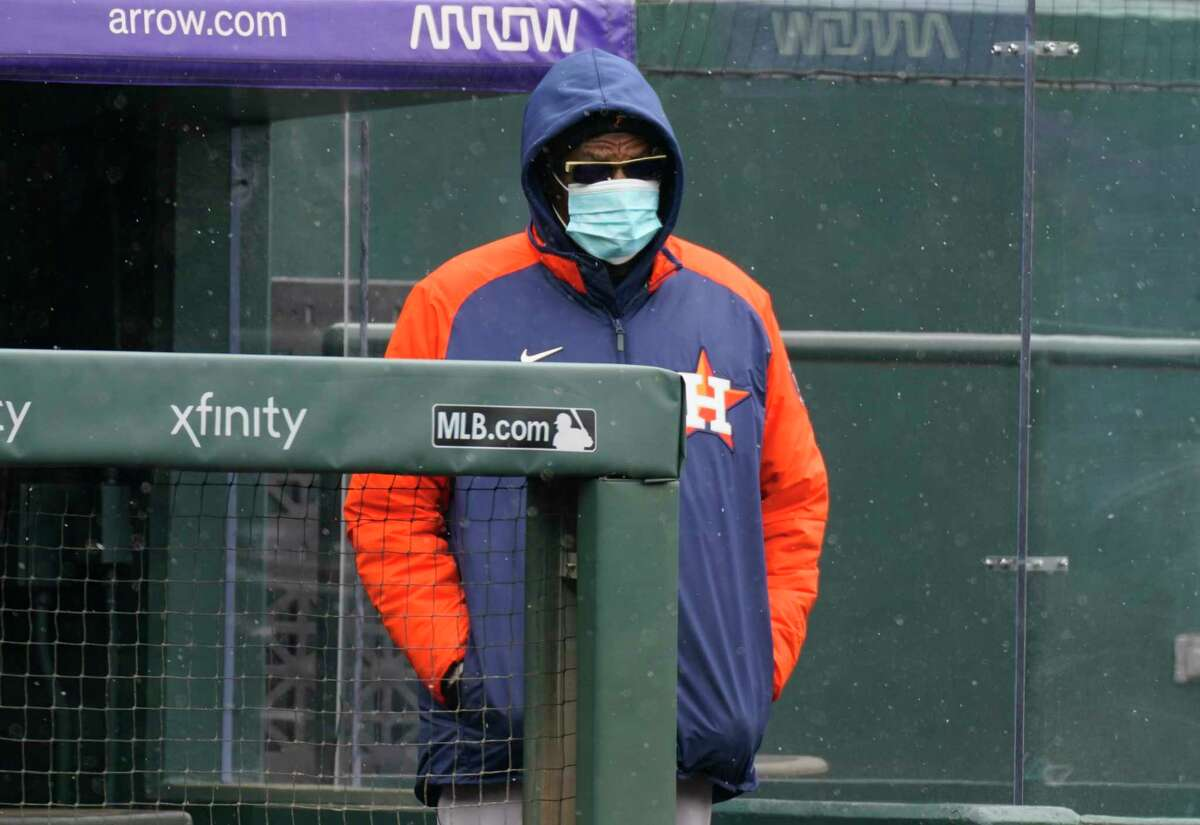 A bundled-up Dusty Baker had to watch his team struggle again amid snowfall at Denver's Coors Field on Wednesday.