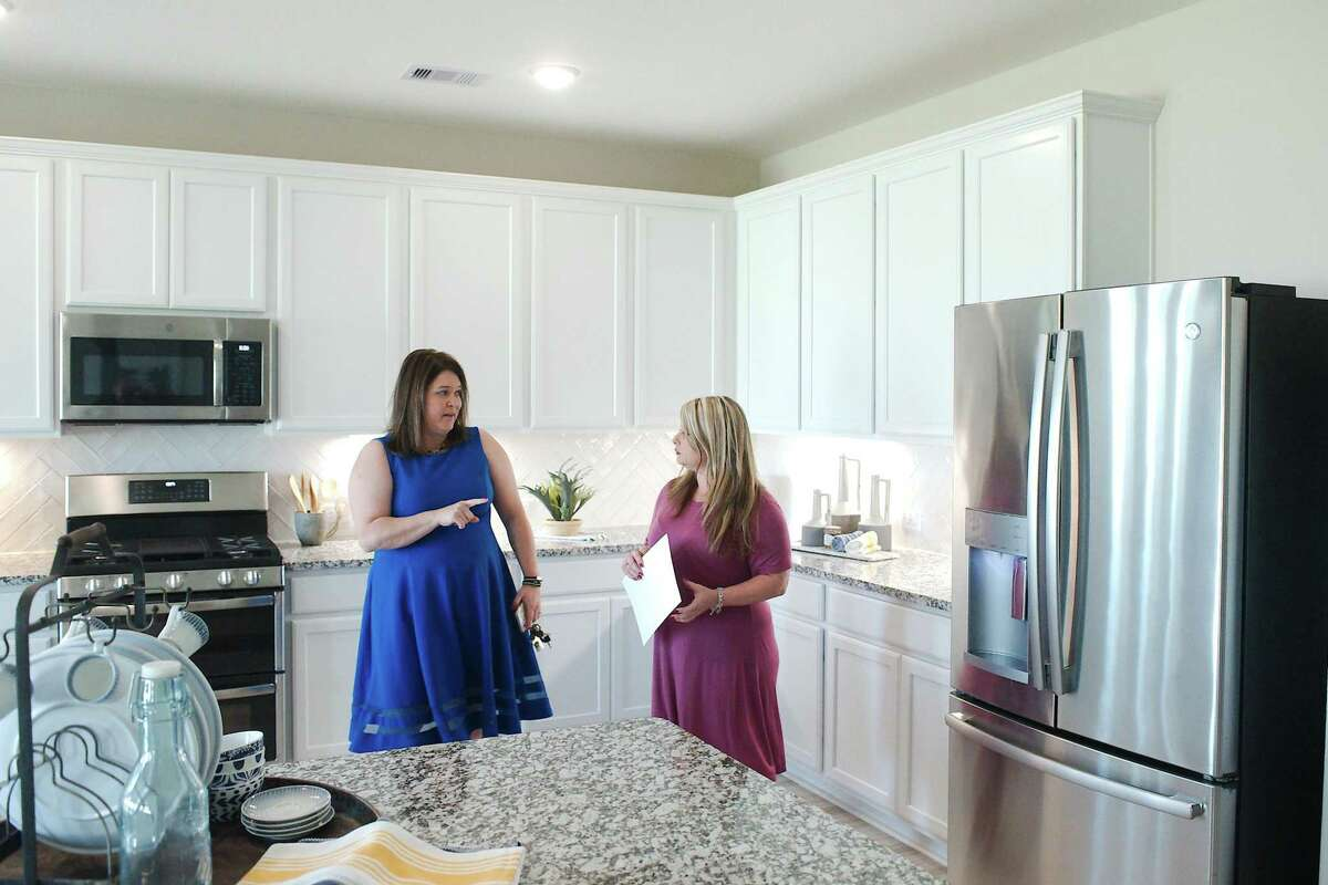 Real estate agent Lindsey Vaughn, left, says the pandemic has caused lifestyle changes that are part of the reason for the surge in home sales in Manvel and Alvin.