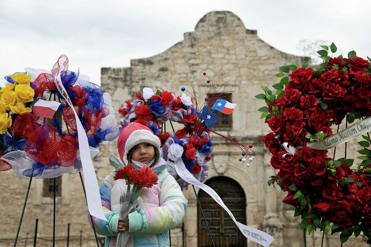 Milagrace Tamez, 4, a descendant of Juan Vargas and a member of the Children of the Republic of Texas, Alamo Couriers Chapter, waits to place flowers in front of the Alamo church in honor of the Battle of San Jacinto and fallen soldiers and volunteers at the Battle of the Alamo on April 21, 2021. She was part of the gathering with the Alamo Couriers and Alamo Mission chapters of the Daughters of the Republic of Texas to place their wreaths there.
