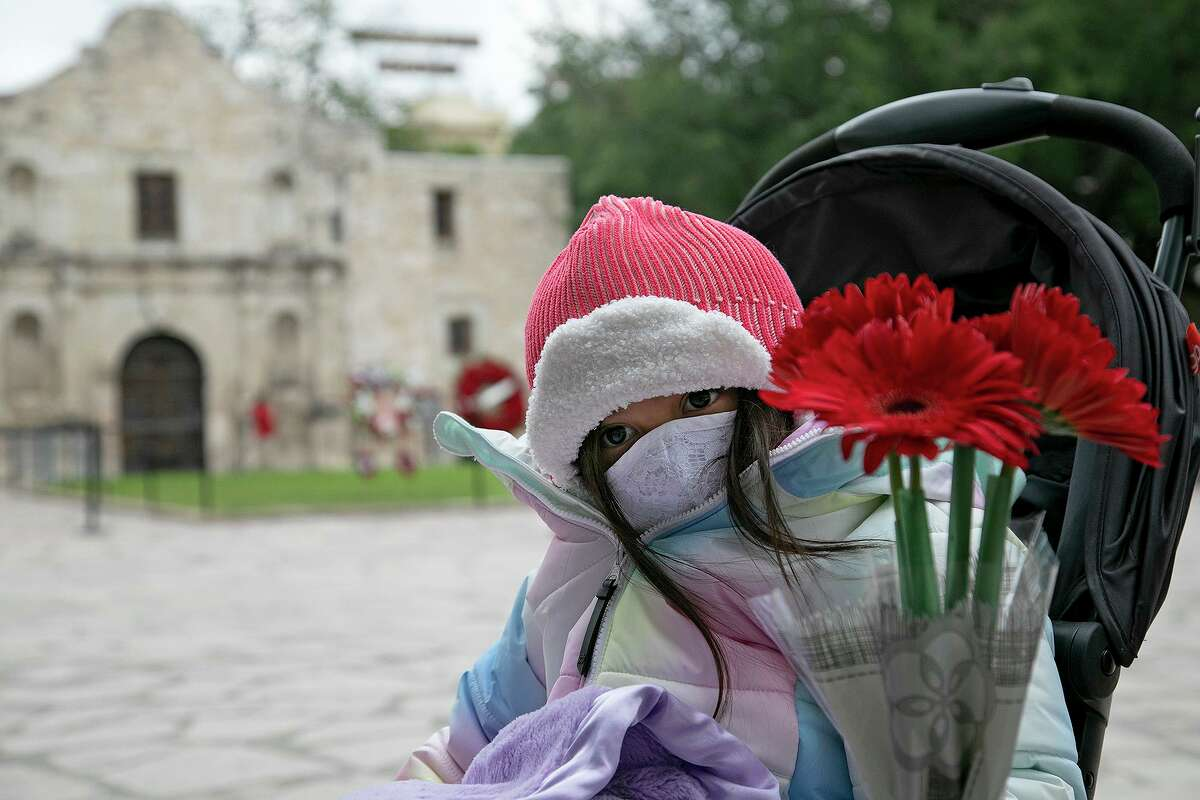 Milagrace Tamez, 4, a descendant of Juan Vargas and a member of The Children of the Republic of Texas, Alamo Couriers Chapter, waits to place flowers in front of the Alamo church in honor of the Battle of San Jacinto and fallen soldiers and volunteers at the Battle of the Alamo on April 21, 2021. She was part of the pilgrimage with the Alamo Couriers and Alamo Mission chapters of the Daughters of the Republic of Texas.