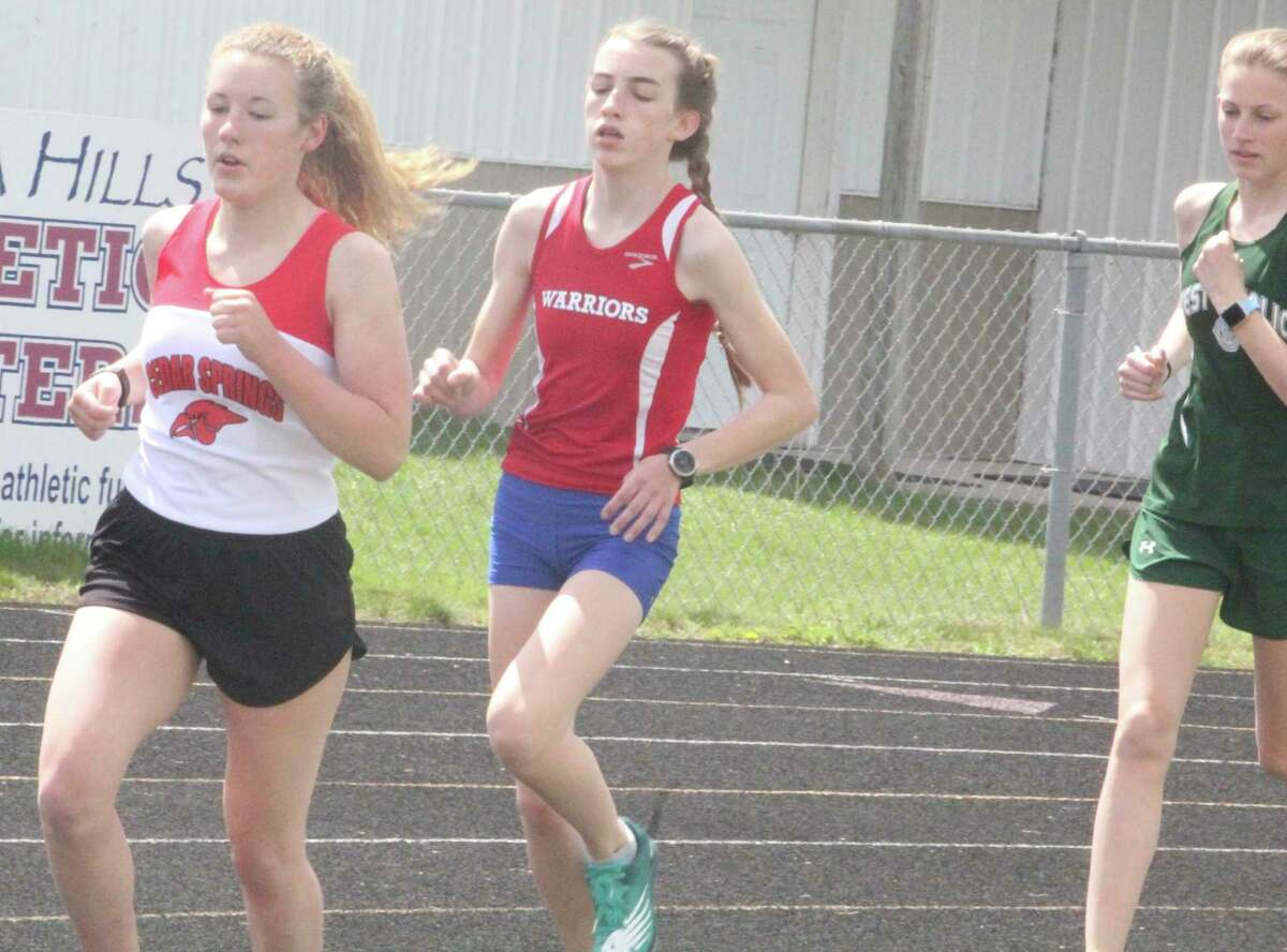 Chippewa Hills' distance runner Haylee Livermore (middle) is expected to be