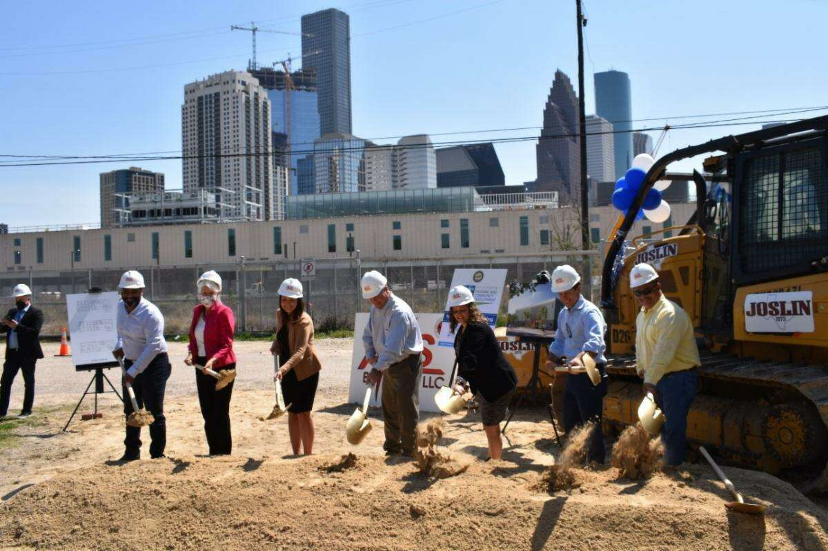 District H City Council Member Karla Cisneros (second from left) and Director Tom McCasland of the City of Houston Housing and Community Development Department (second from right) participate in groundbreaking ceremony at Harmony House March 24.