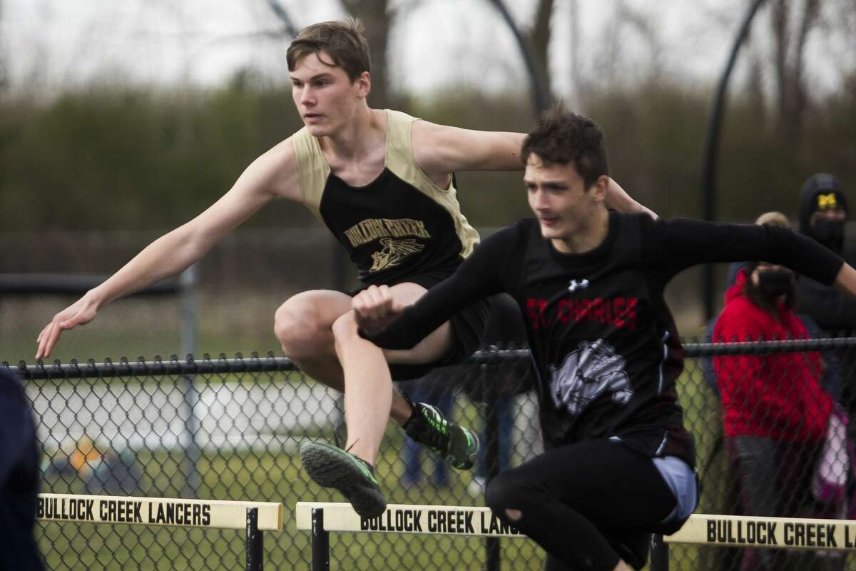 Bullock Creek's Jacob Inman competes in the 110 meter hurdles event during a track meet Wednesday, April 21, 2021 at Bullock Creek High School. (Katy Kildee/kkildee@mdn.net)