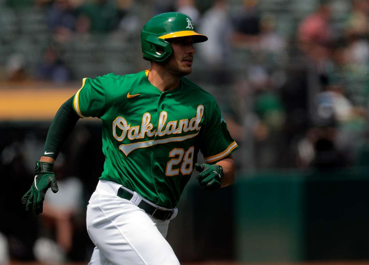 Matt Olson (28) rounds the bases on his solo homerun in the second inning as the Oakland Athletics played the Minnesota Twins at the Oakland Coliseum in Oakland, Calif., on Wednesday, April 21, 2021.
