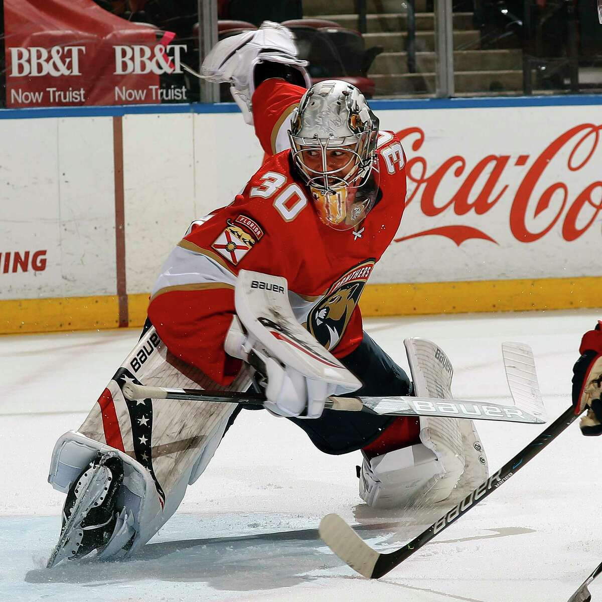 Panthers goalie Spencer Knight, a Darien native, defends the net against the Columbus Blue Jackets at the BB&T Center on Tuesday in Sunrise, Fla. Knight made 33 saves in his NHL debut, a 5-1 win.