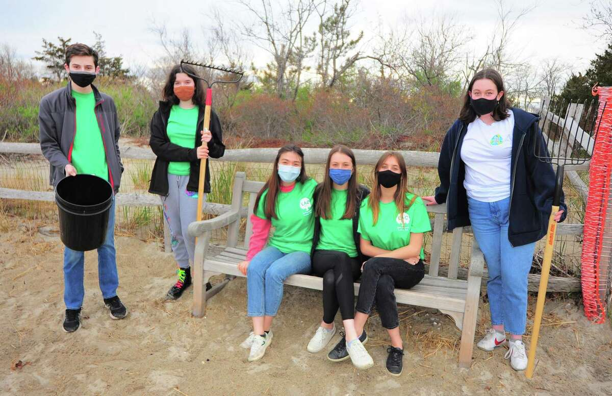 Members of the Environmental Action Club get some cleanup time in ahead of Saturday's annual beach cleanup event at Tod's Point beach in Greenwich, Conn., on Wednesday April 21, 2021. From left to right is Benjamin Cooper, Isabelle Harper, Annika Wolle, Genevieve McQuillan, Gabriella Meyerhoff and Caitlin O'Brien. The event is held in honor of their former classmate Luke Meyers, who died in 2019 after a 20-month battle with glioblastoma.