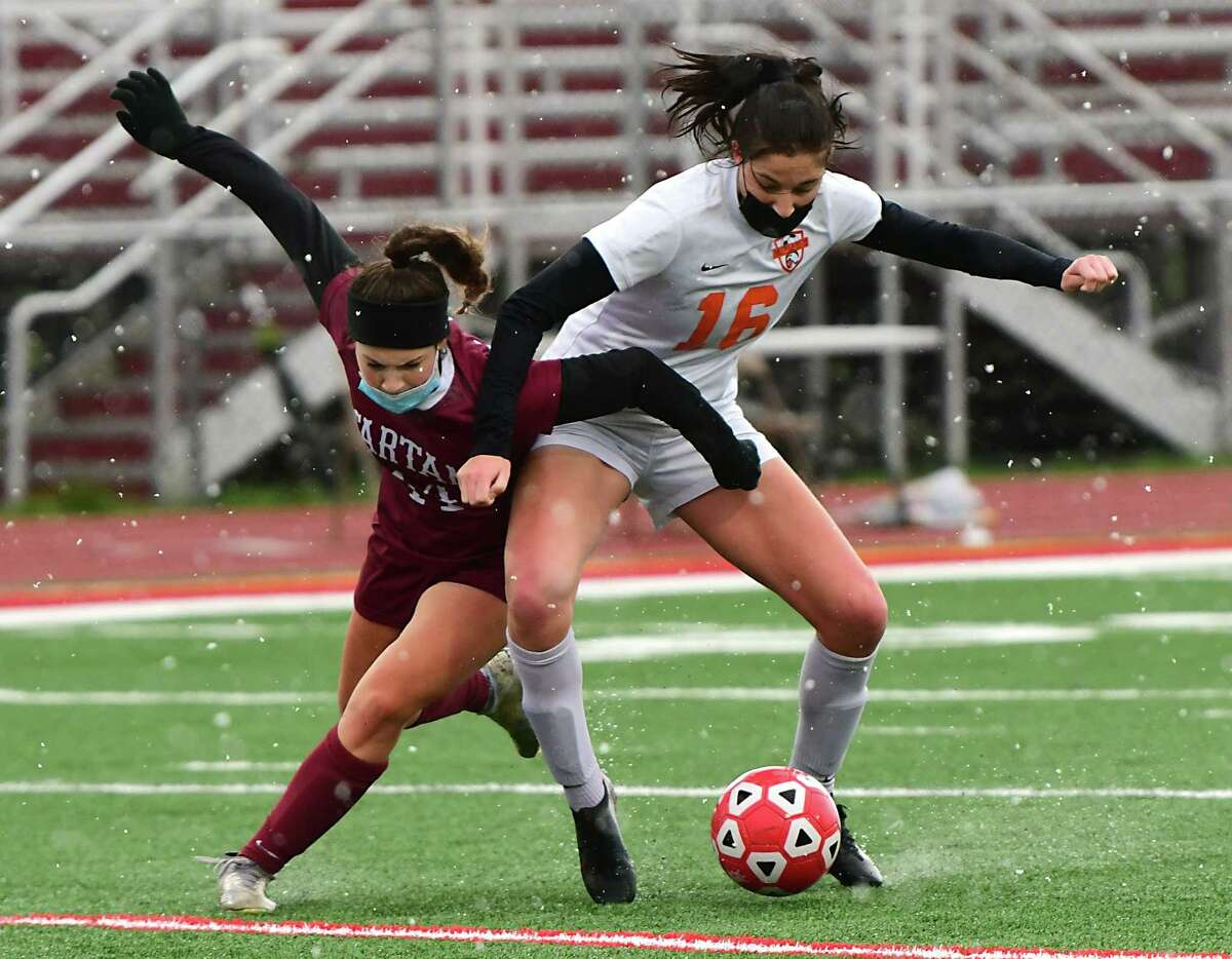 Scotia-Glenville's Brooklyn Drago, left, battles for the ball with Bethlehem's Jo Van Royen during a soccer game on Wednesday, April 21, 2021 in Scotia, N.Y. (Lori Van Buren/Times Union)