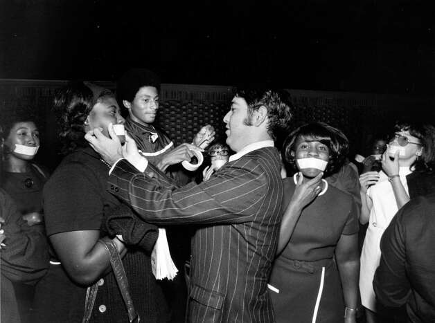 Nursing students from Prairie View A&M School of Nursing, led by junior Alphonse Pinter, have their mouths taped in protest of administration policy and student living conditions on Oct. 20, 1970. Students attending the school live at the YWCA instead of in a dorm and have had their financial support cut. Photo: Fred Bunch, HP Staff / Houston Chronicle / Houston Post files