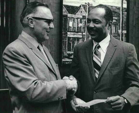 Roy L. Dye Jr., left, Houston area manager for Sears, Roebuck and Co., presented a Sears-Roebuck Foundation check in the amount of $2,100 to Dr. G. M. Sawyer, right, president of Texas Southern University on Oct. 15, 1969. Dye said the check will be used in support of education programs for which the state does not appropriate funds. Photo: Houston Chronicle File / Houston Chronicle