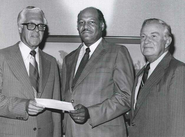 The Exxon U.S.A. Foundation contributed $10,000 to the $2 million fund drive for the benefit of Texas Southern University. In this June 19, 1977, photo. Randall Meyer, left, president of Exxon Company U.S.A., is shown with Andrew Jefferson, chairman of the Texas Southern University Foundation and Willard Walbridge, chairman of Campaign 77, which conducted the drive. The funds were for academic progress, scholarship aid and institutional projects. Photo: Houston Chronicle File