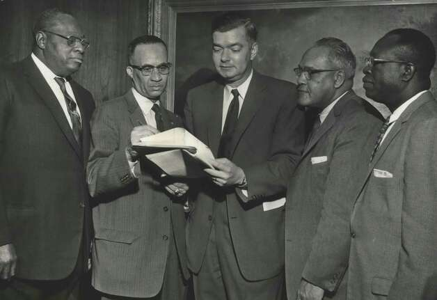 In this April 6, 1958, photo, a committee discussion takes place regarding a fundraising drive for the United Negro College Fund. From left, Hobart Taylor, businessman; Dr. John E. Codwell, Wheatley High principal; John T. Jones Jr., president of The Chronicle; Dr. F. D. Patterson, New York, president of the fund, and Dr. J.J. Seabrook, president of Huston-Tillotson College, discuss the $2.25 million UNCF Drive. The local men served on the committee raising Houston's portion of the campaign. Money raised in the national effort was divided among 33 private historically Black colleges across the country. Photo: Houston Chronicle File