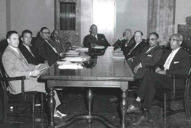 """As published in the Houston Chronicle in July 31, 1958, """"The Board of Directors of Texas Southern University take time out of their meeting on campus to pose for the university photographer. From left to right Price Crawley, Attorney Ralph B. Lee, Dr. John Davis, President S.M. Nabrit Mr. Mack H. Hannah, Chairman; Dr. H.D. Bruce, Dr. J. Carroll Chadwick, Mr. George L. Allen and Dr. W. R. Banks. Under the guidance of the present Board of Directors, the Houston, Texas school has made tremendous steps forward. The plant has expanded by leaps and bounds. Present plans of construction call for an expansion of the School of Pharmacy; completion of the Student Union Building; construction of a dormitory for athletes; air conditioning present administrative offices; construction of $300,000.00 Physical Education facility for swimming and P.E.classes; a resettlement of the School of Vocational and Industrial Education in the Fairchild Building; and the construction of administrative offices in the area formerly occupied by the university library."""" Photo: Houston Chronicle File"""