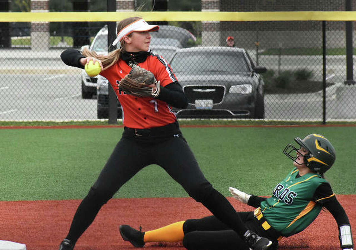 Edwardsville shortstop Jayna Connoyer fires a throw to first base to try and complete a double play against Southwestern during Wednesday's game at Plummer Family Park in Edwardsville.