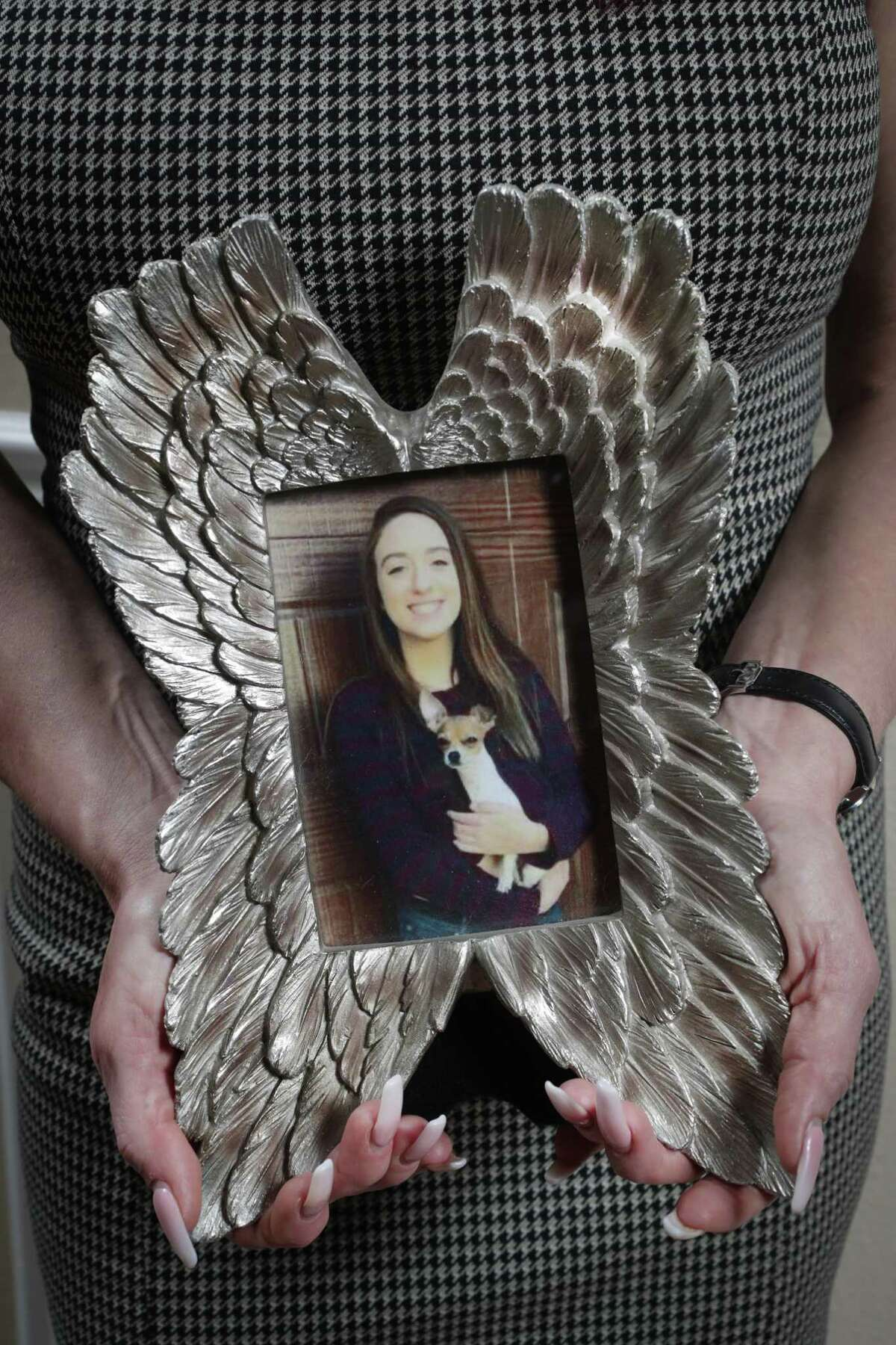 Marentha Sargent holds a photo of her daughter, Adrienne, who died in 2017 when the child of a family friend discharged a firearm that had been left on a kitchen table.