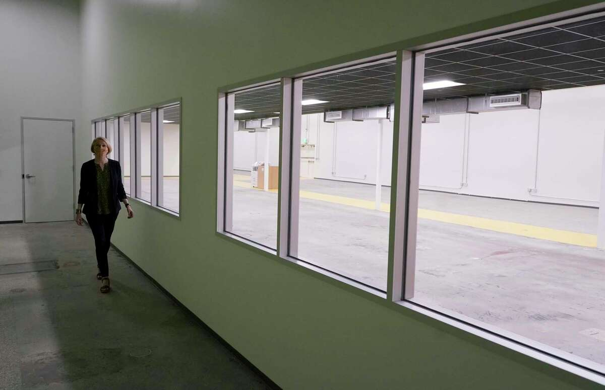 Emily Reichert, CEO, walks passed a prototyping lab at Greentown Labs, 4200 San Jacinto Street, Wednesday, April 21, 2021 in Houston. Greentown Labs is a climatetech and cleantech startup incubator.