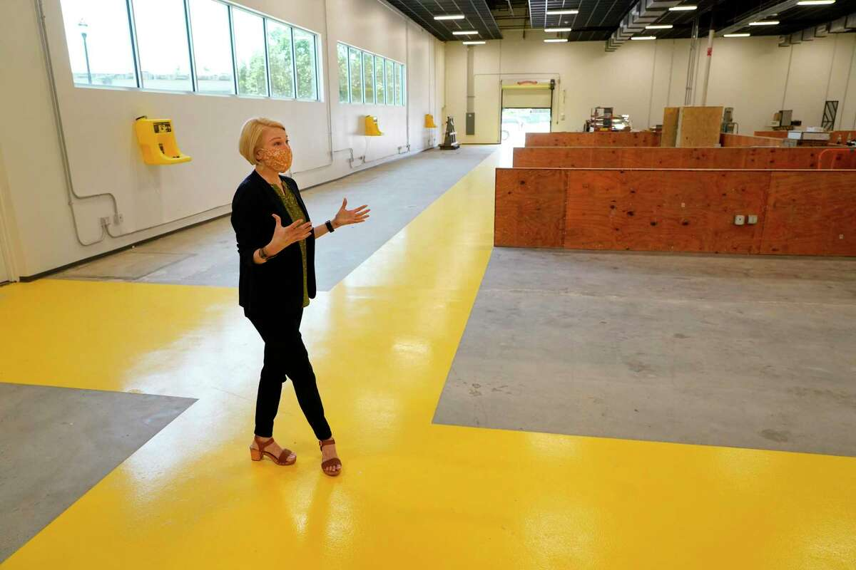 Emily Reichert, CEO, talks in a prototyping lab area at Greentown Labs, 4200 San Jacinto Street, Wednesday, April 21, 2021 in Houston. Greentown Labs is a climatetech and cleantech startup incubator.