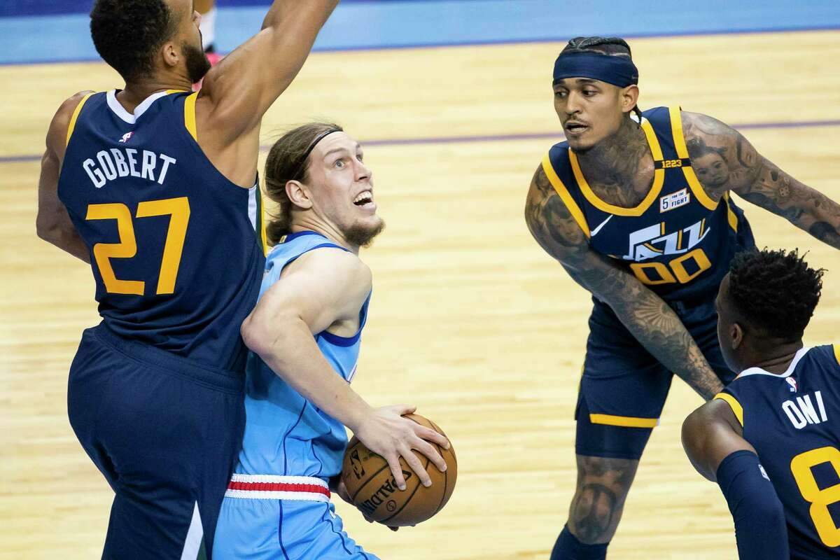 Jazz center Rudy Gobert (27) was an imposing presence against Kelly Olynyk and the Rockets on Wednesday night as Utah rolled to a win at Toyota Center.