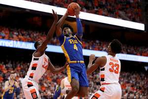 SYRACUSE, NEW YORK - JANUARY 25: Gerald Drumgoole Jr. #4 of the Pittsburgh Panthers drives to the basket as Bourama Sidibe #34 and Elijah Hughes #33 of the Syracuse Orange defend him during the first half of an NCAA basketball game at the Carrier Dome on January 25, 2020 in Syracuse, New York. (Photo by Bryan Bennett/Getty Images)