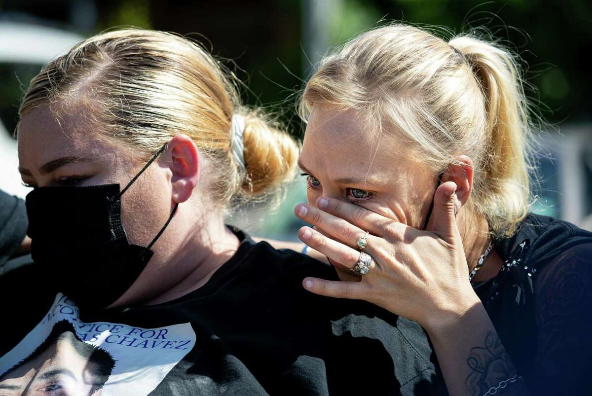 Jessica Chavez, right, wipes away tears Wednesday as family members of Nicolas Chavez speak to reporters about the death of her boyfriend, who was killed as he suffered a mental health crisis.