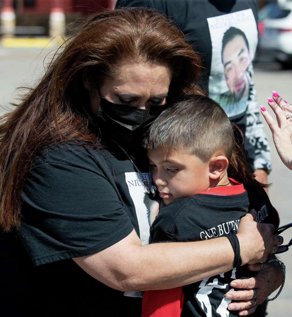 Leantha Chavez hugs her grandson Nicolas Chavez Jr., 6, during a cookout to mark one year since her son, Nicolas Chavez, was fatally shot by Houston Police, on Wednesday, April 21, 2021, in Houston.