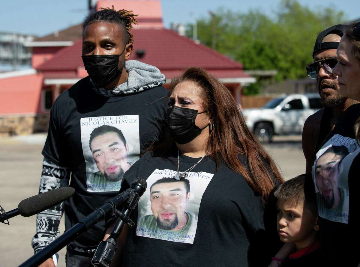 Leantha Chavez, center, speaks to reporters near the memorial site for her son, Nicolas Chavez, on Wednesday, April 21, 2021, in Houston. Chavez's family is marking one year since his death by holding a cookout on the intersection where he was fatally shot by Houston Police.