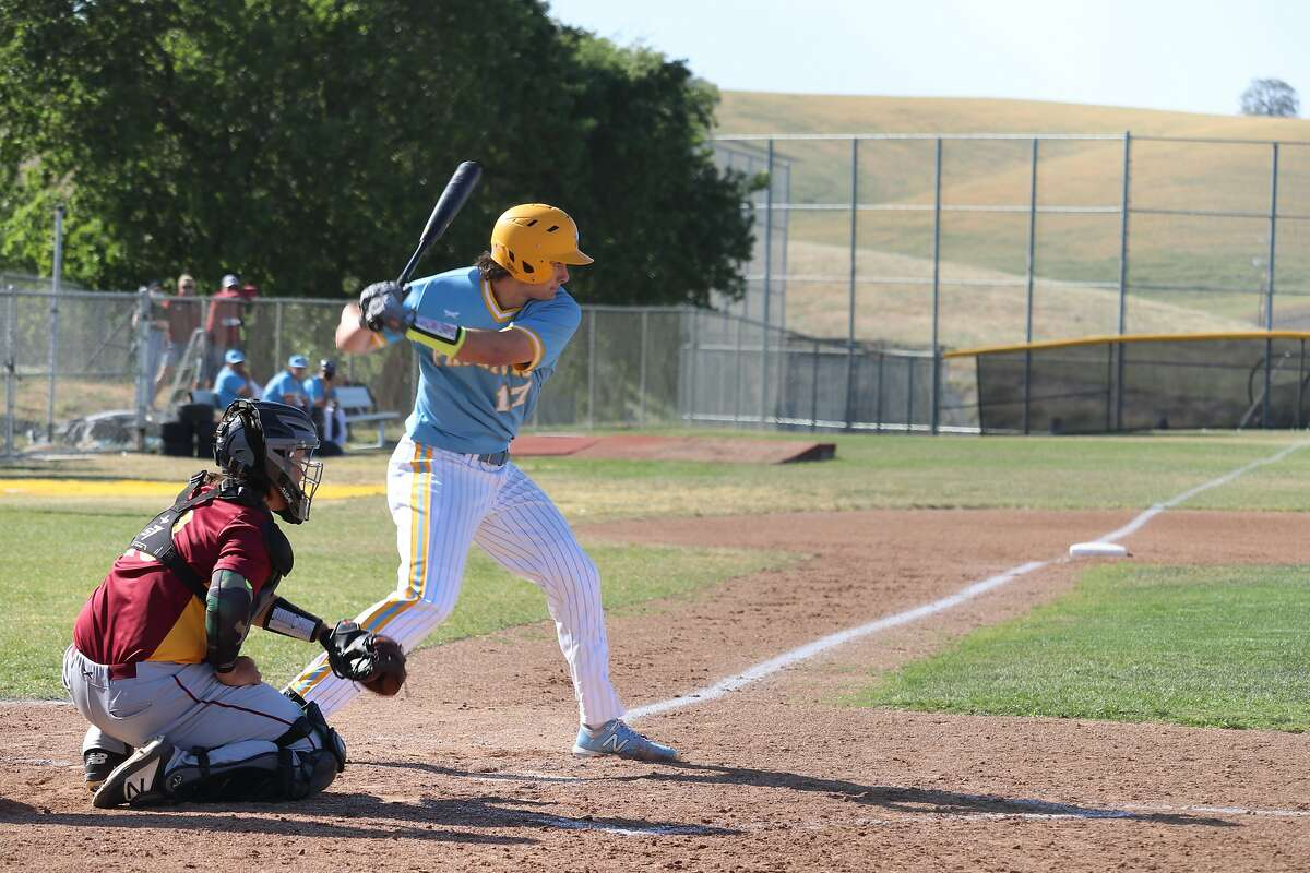 Heritage senior Brad Ehlen loads up his swing, prior to hitting a two-run home run in a victory over Liberty last week.