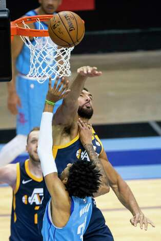 Utah Jazz center Rudy Gobert (27) blocks a shot by Houston Rockets center Christian Wood (35) during the second quarter of an NBA game between the Houston Rockets and Utah Jazz on Wednesday, April 21, 2021, at Toyota Center in Houston. Photo: Mark Mulligan, Staff Photographer / © 2021 Mark Mulligan / Houston Chronicle
