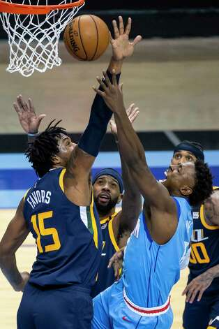 Houston Rockets forward Jae'Sean Tate (8) tries to shoot around Utah Jazz center Derrick Favors (15) during the second quarter of an NBA game between the Houston Rockets and Utah Jazz on Wednesday, April 21, 2021, at Toyota Center in Houston. Photo: Mark Mulligan, Staff Photographer / © 2021 Mark Mulligan / Houston Chronicle