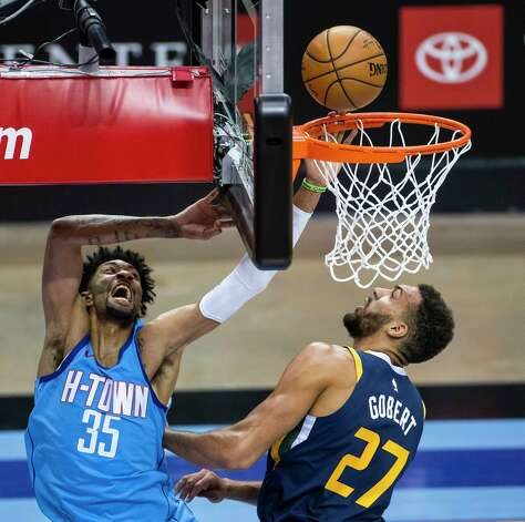 Houston Rockets center Christian Wood (35) shoots over Utah Jazz center Rudy Gobert (27) during the second quarter of an NBA game between the Houston Rockets and Utah Jazz on Wednesday, April 21, 2021, at Toyota Center in Houston. Photo: Mark Mulligan, Staff Photographer / © 2021 Mark Mulligan / Houston Chronicle