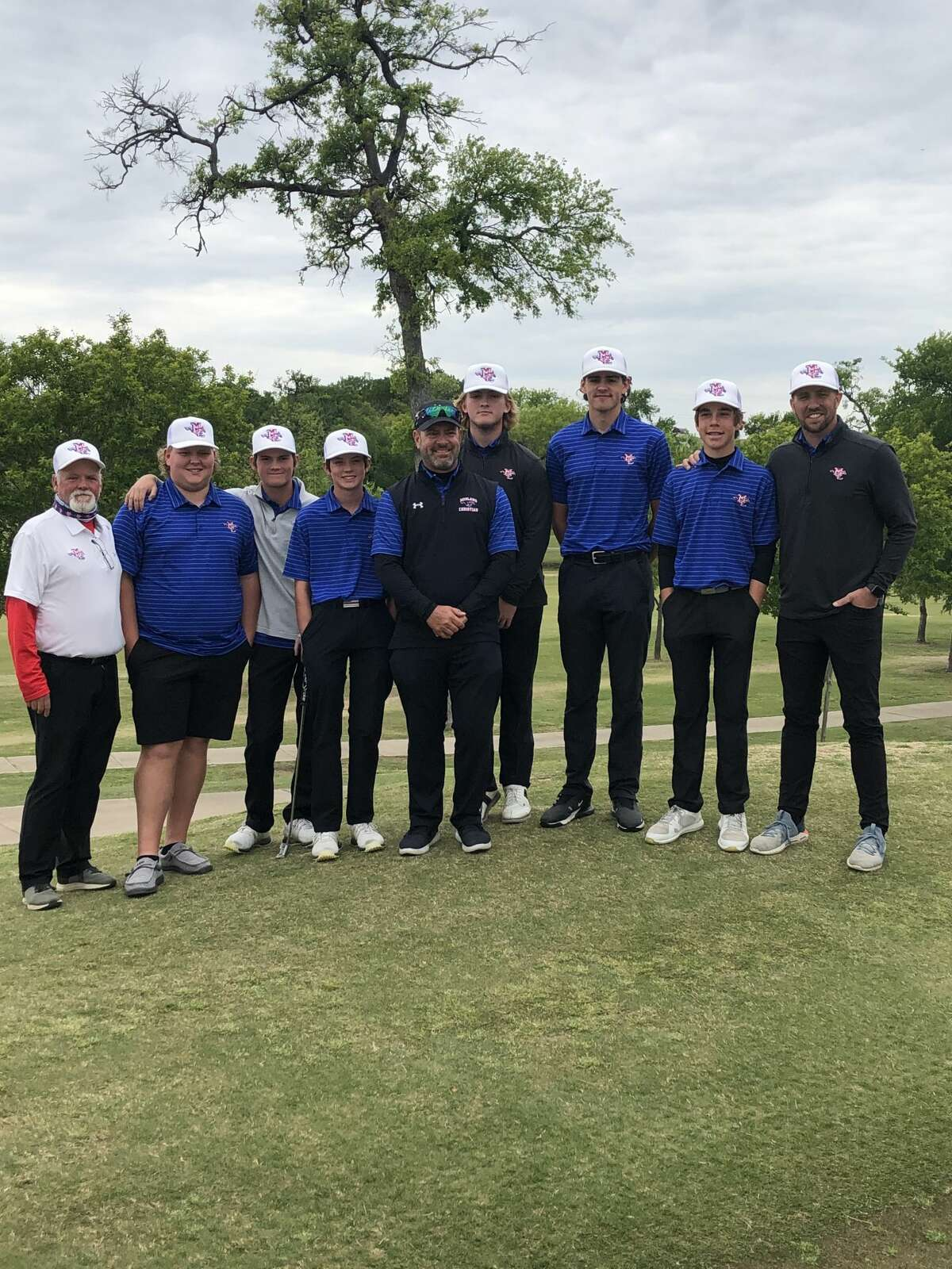 The Midland Christian boys golf team poses for a team picture after it qualified for the state tournament with a fourth-place finish at the TAPPS6A Region I Golf Tournament, April 21 in Richardson.