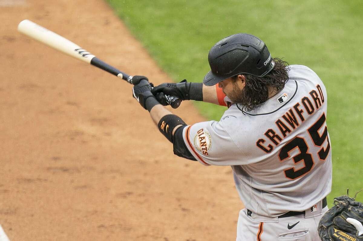 San Francisco Giants' Brandon Crawford in action during the fifth inning of a baseball game against the Philadelphia Phillies, Wednesday, April 21, 2021, in Philadelphia. The Phillies won 6-5. (AP Photo/Chris Szagola)
