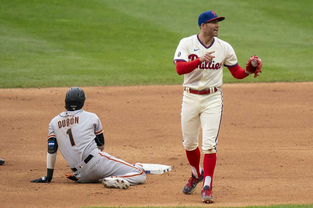 Phillies second baseman Brad Miller reacts to tagging out Mauricio Dubon as he tried to stretch a single into a double.
