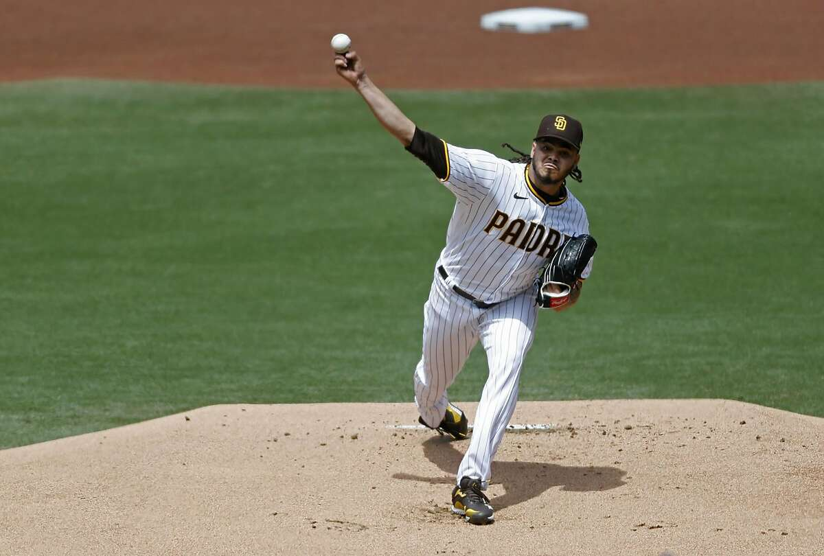 Padres starter Dinelson Lamet struck out four Brewers batters in two innings before exiting with forearm tightness.