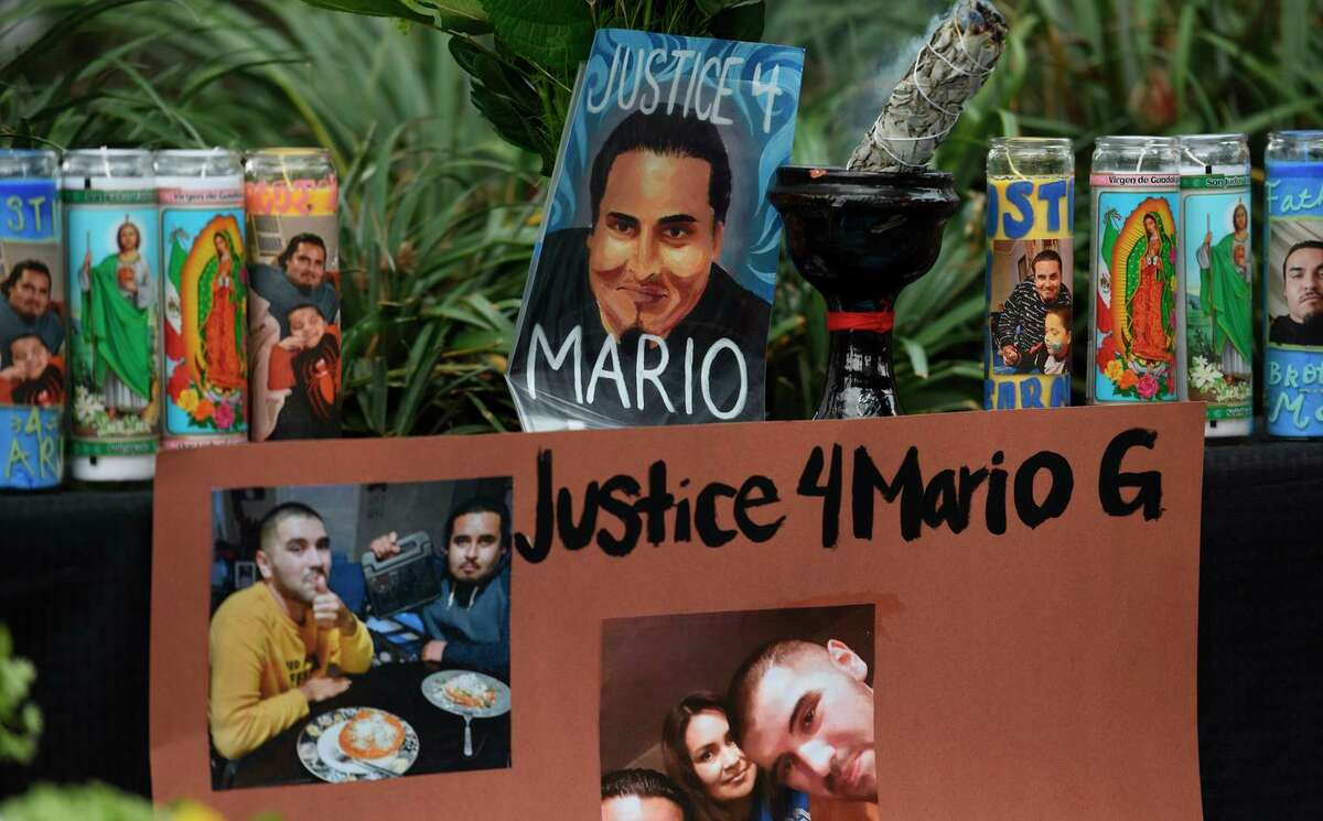 Sage burns at an altar during a press conference to demand answers from Alameda police about the death of Mario Gonzalez in Alameda, Calif. on Wednesday, Apr 21, 2021. Gonzalez, a father and caretaker,died in Alameda police custody Monday and his family has heard nothing about the cause of his death.