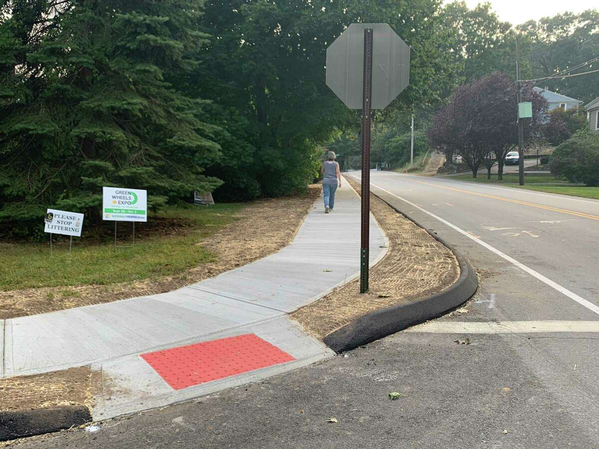 View of Wilson Street heading west, with a Stratfield resident enjoying a walk down the brand new completed sidewalk.