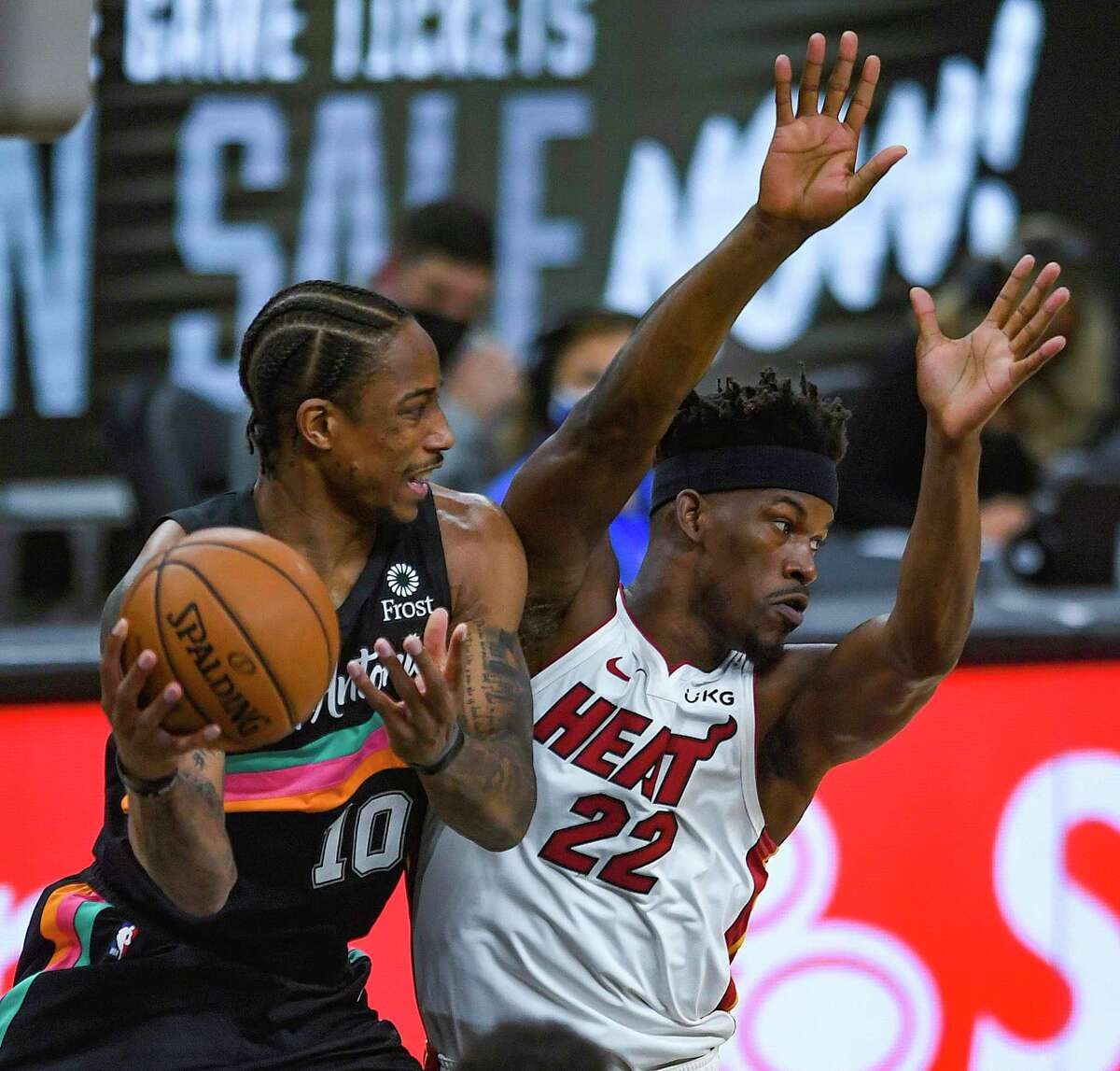 DeMar DeRozan (10) of the San Antonio Spurs dishes off for an assist against Jimmy Butler (22) of the Miami Heat during NBA action in the AT&T Center on Wednesday, April 21, 2021.