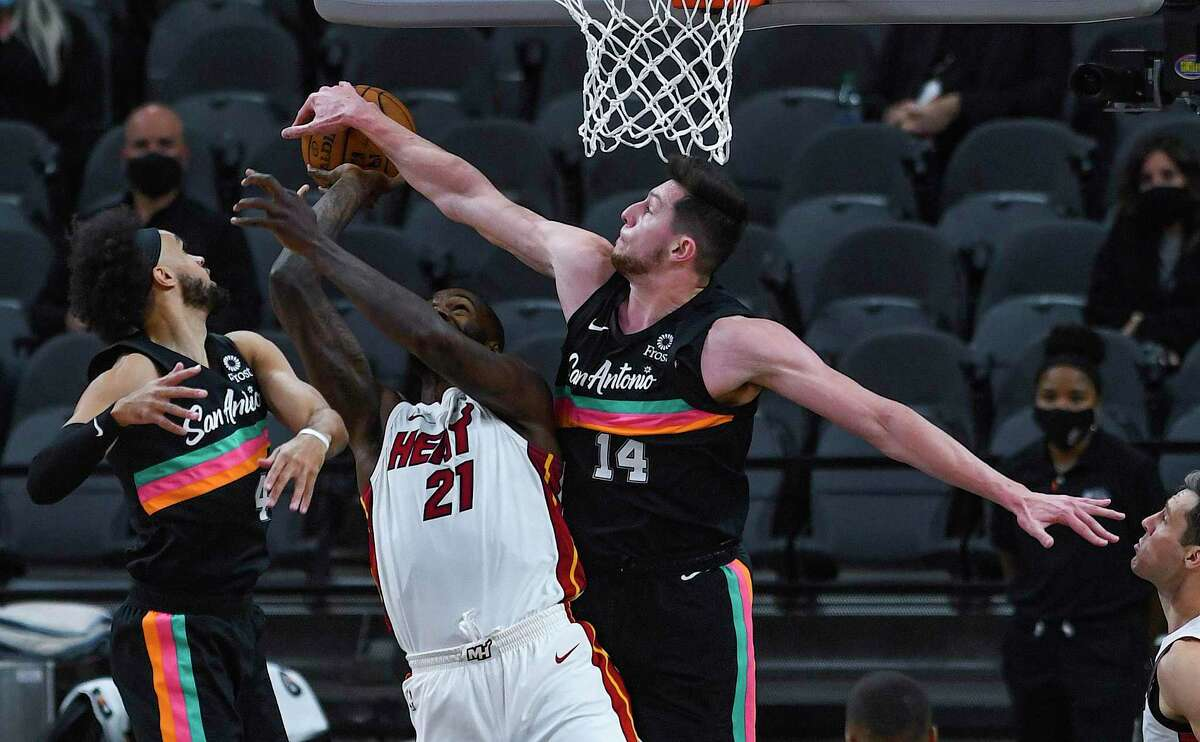 Drew Eubanks (14) of the San Antonio Spurs blocks a shot by Dewayne Dedmon of the Miami Heat during NBA action in the AT&T Center on Wednesday, April 21, 2021.