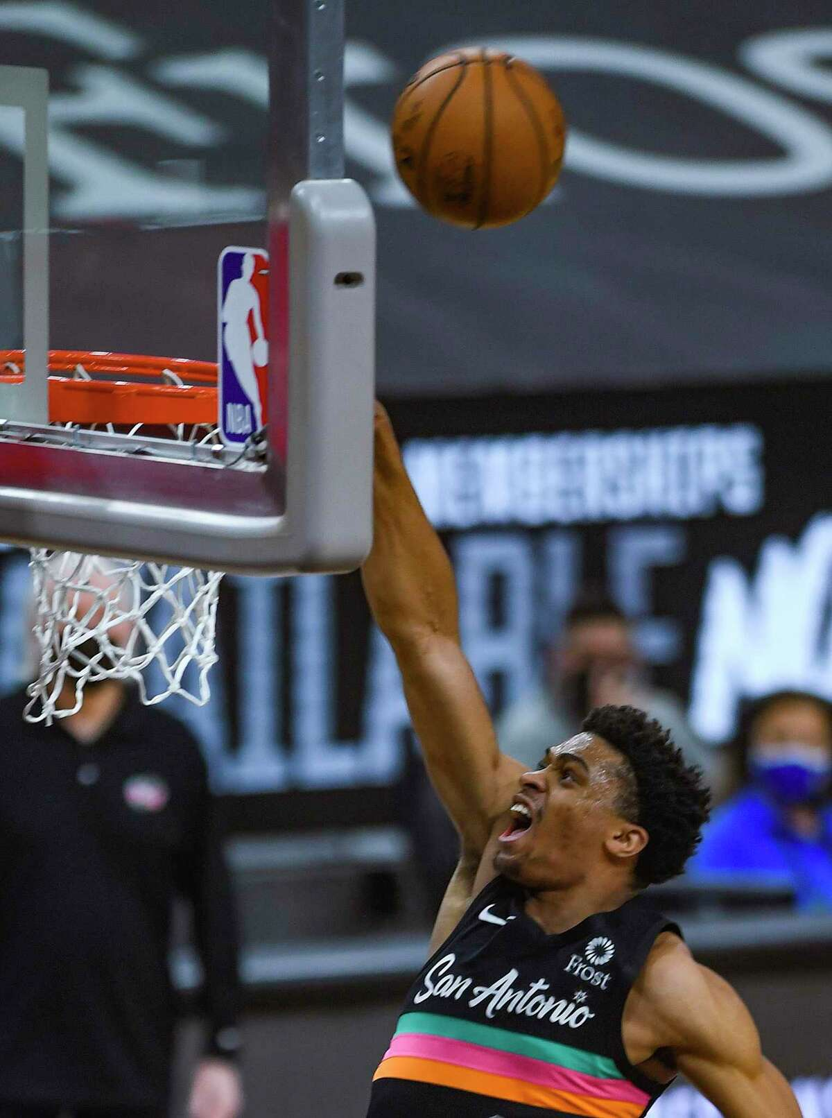 Keldon Johnson of the San Antonio Spurs misses a dunk attempt against the Miami Heat during NBA action in the AT&T Center on Wednesday, April 21, 2021.