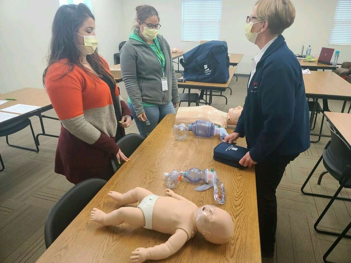 Lake County 911 Dispatch employees conducting Basic Life Support CPR training. (Submitted photo)