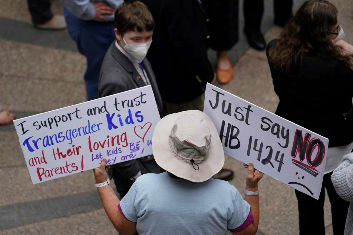 Parents of transgender children and other supporters of transgender rights gather in the capital outdoor rotunda to speak about transgender legislation being considered in the Texas House and Texas Senate, Wednesday, April 14, 2021, in Austin, Texas. (AP Photo/Eric Gay)