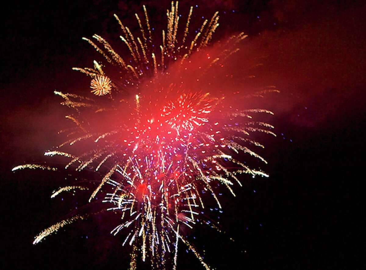 Fireworks sponsored by the Greater New Milford Chamber of Commerce light up the night during New Milford's Fourth of July celebration, July 3, 2015