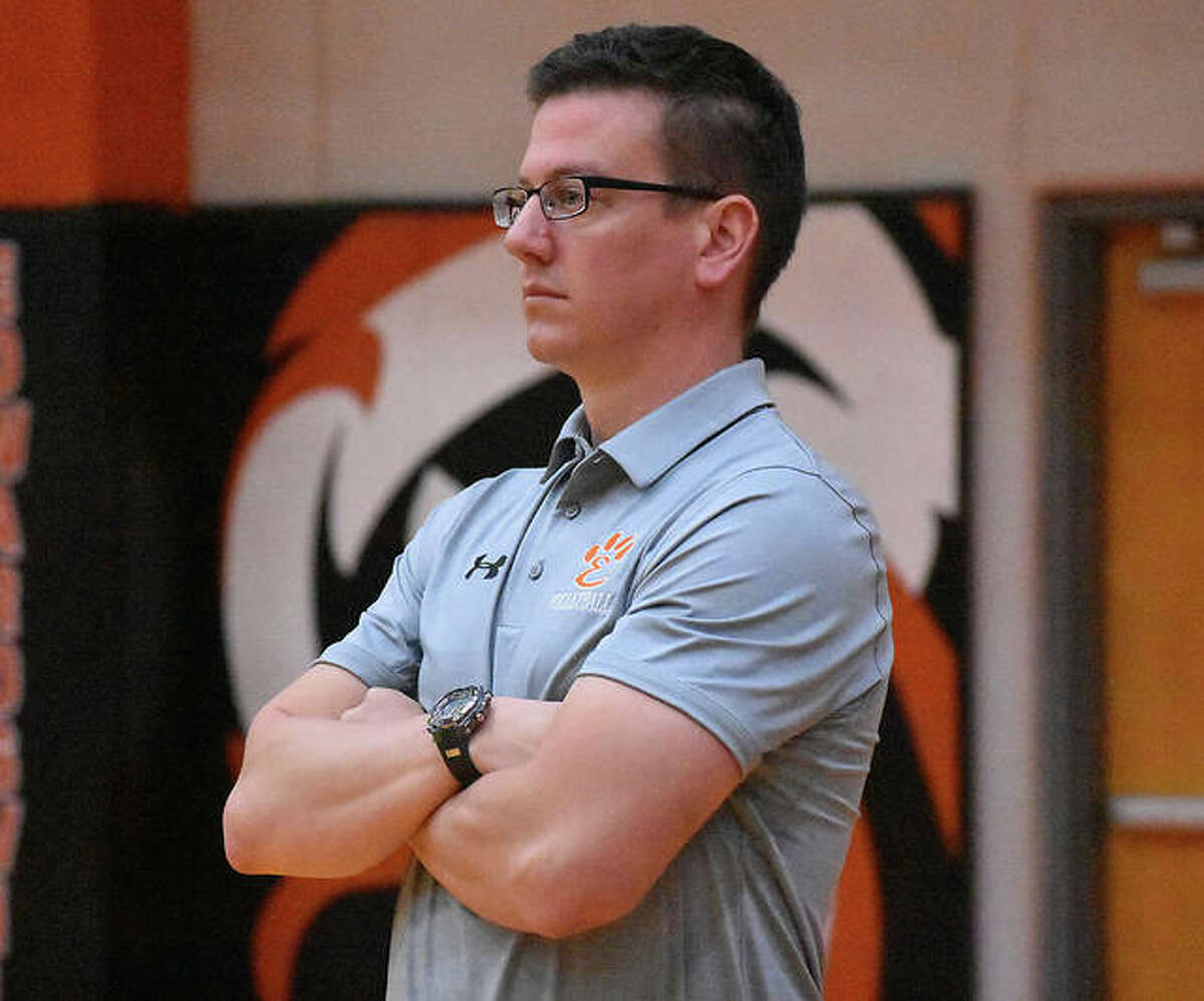 Edwardsville coach Scott Smith watches his team from the bench during a 2019 match against O'Fallon inside Lucco-Jackson Gymnasium.