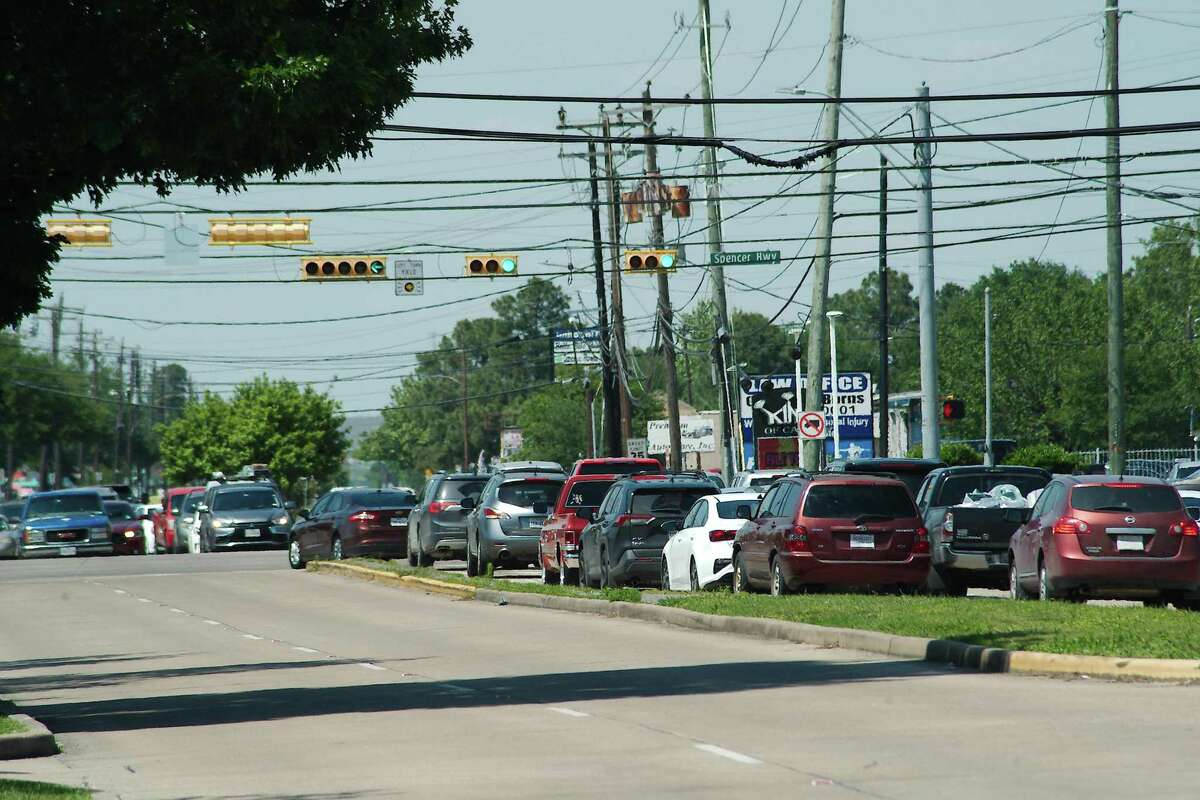 Traffic on Strawberry Road backs up at the traffic light at Spencer Highway in Pasadena. The crossing is one of various intersections along Spencer Highway identified for focus through a study aimed at making recommendations for improved and safer mobility in southeast Harris County.