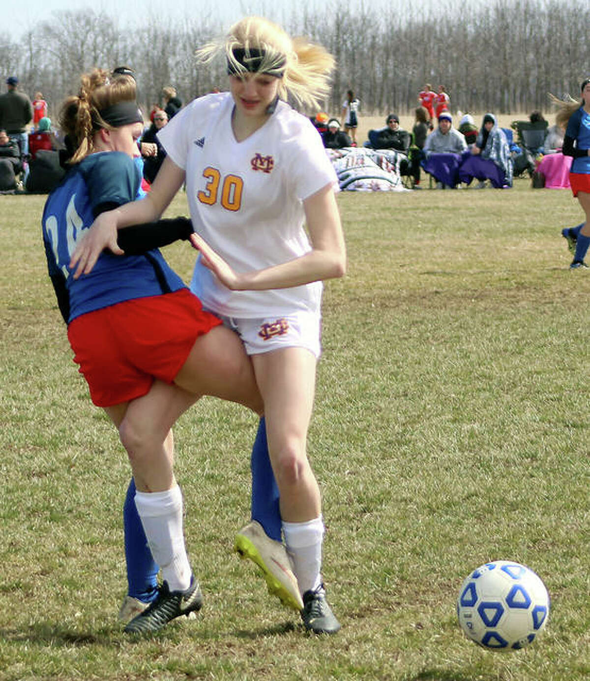 Claire Christeson of Civic Memorial, right, had a pair of assists in her team's 8-2 victory at Highland Wednesday. Christeson is shown in 2019 action against Carlinville.